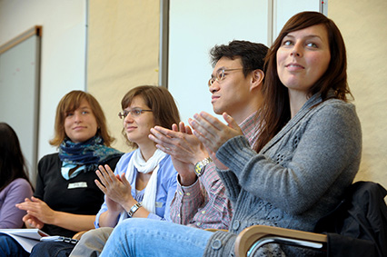 Photo: Clapping PhD Students